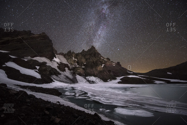 The Milky Way Galaxy moves across a clear night sky from No Name Lake taken in the Three Sisters Wilderness