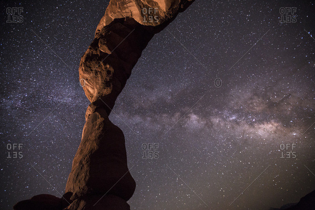 The Milky Way pierces Utah's famous Delicate Arch in Arches National Park