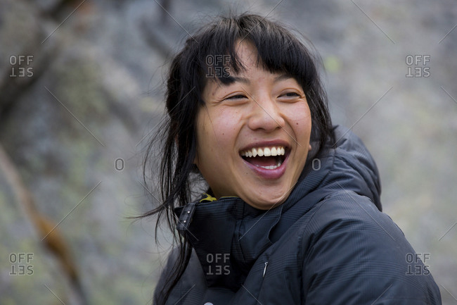 Laughing Taiwanese woman on Mt Evans, Colorado
