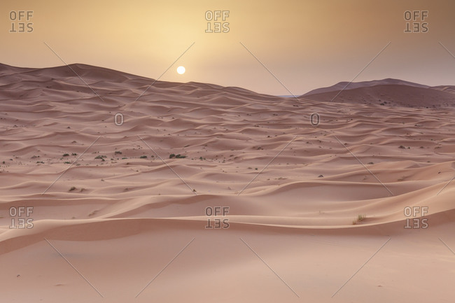 Sunset over red sand dunes in the Sahara desert at Erg Chebbi, Merzouga Morocco