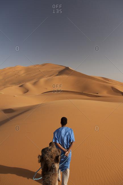 Tuareg Camel driver in Sahara desert Erg Chebbi, Merzouga Morocco