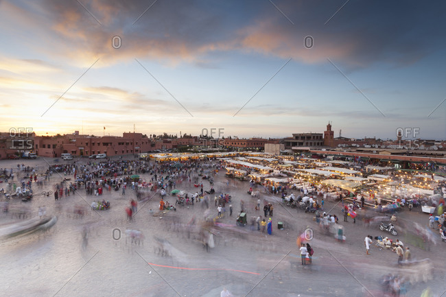 Jemaa al Fna square with crowds and food stalls at sunset Marrakesh, Morocco