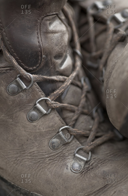 Close up of a pair of old hiking boots