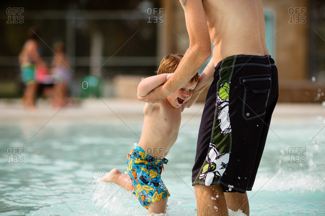 Father playing with his son in a swimming pool