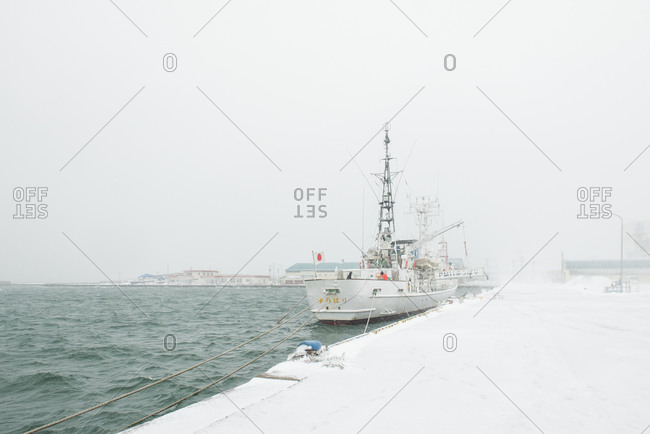 Ship at port during winter in Japan