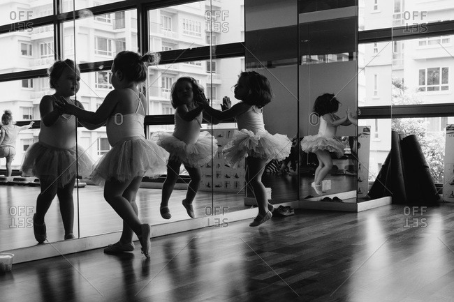 Little dancers watch themselves in a mirror