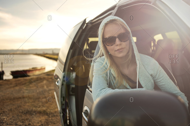 Woman looking out of passenger side window