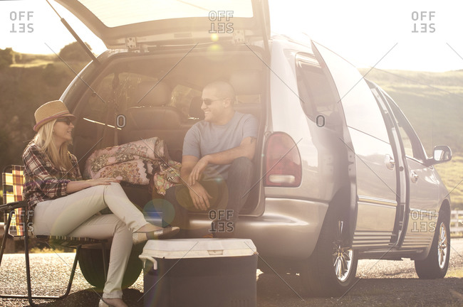 Couple taking a break during a road trip