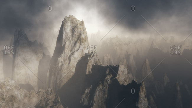 Photo illustration of craggy bare rock pinnacles in misty, ethereal landscape