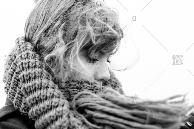 Close up of a woman wrapped in a knit scarf