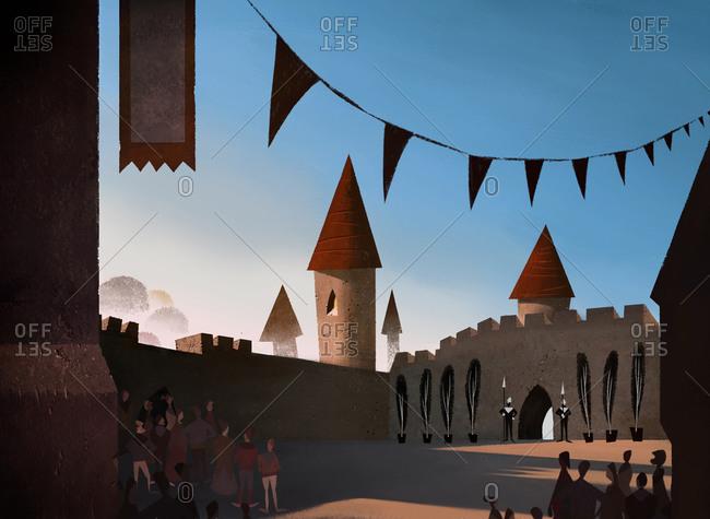 People standing in medieval courtyard