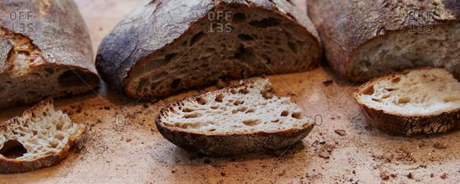 Three loafs and three slices of pane di como antico