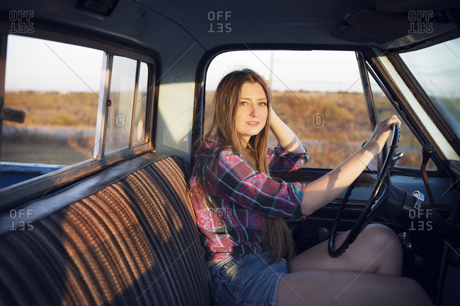 Young woman driving a pick up truck