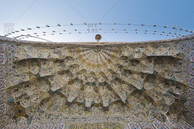 Shiraz, Iran - April 20, 2015: Tile decorations of the front door ceiling, Vakil mosque