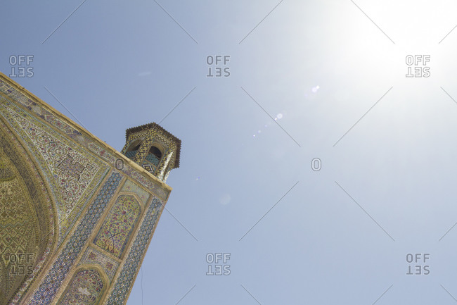Shiraz, Iran - April 20, 2015: Iwan of the Vakil mosque and blue sky