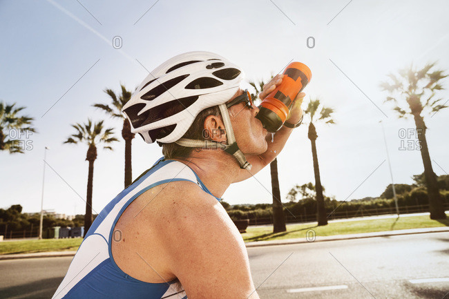 Triathlete drinking water on bicycle