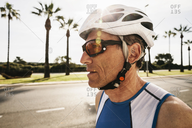 Portrait of triathlete with cycling helmet