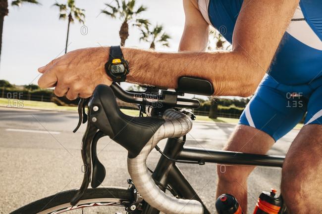 Triathlete training on bicycle, close-up
