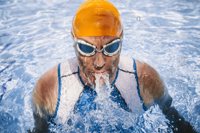 Triathlete swimmer coming out of the water