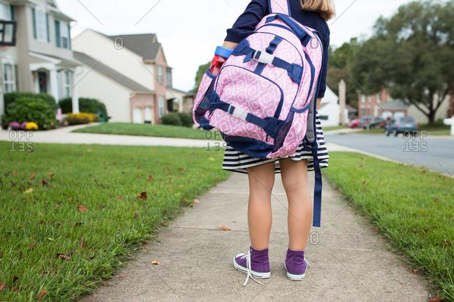 Girl wearing her school backpack