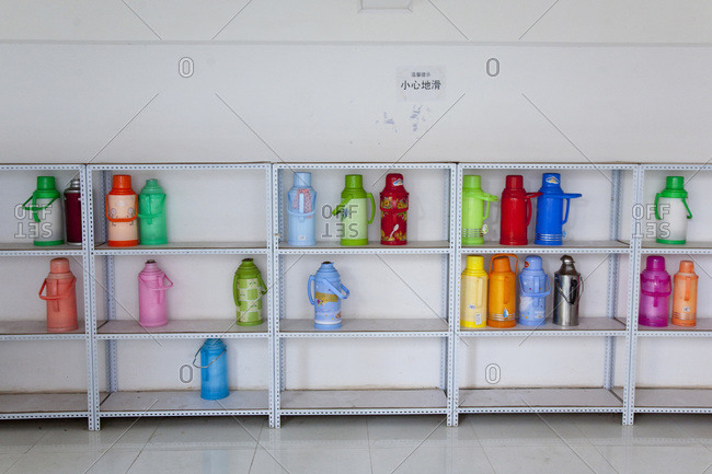 Canteen bottles on a rack at a dormitory in Kunming, Yunnan, China