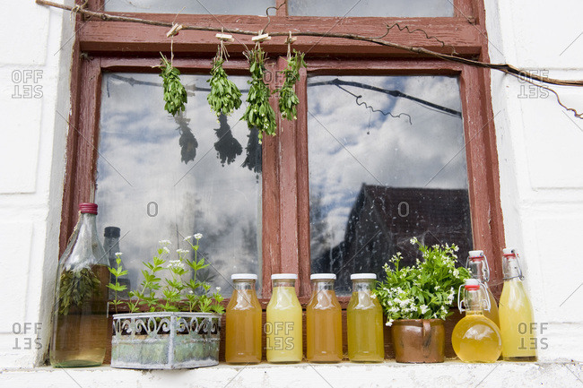 Syrup, juice and liqueur on a window sill