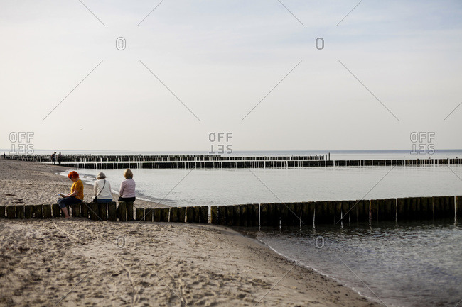 People sitting at a beach in Nienhagen, Germany