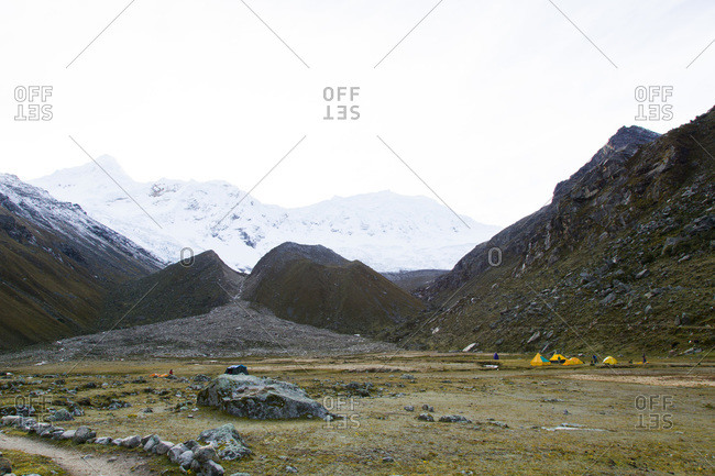 Base camp in Ishinca Valley with Tocllaraju in the background, Peru