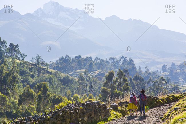 Two Peruvians walking on a road in Mount Churup, Andes, Peru