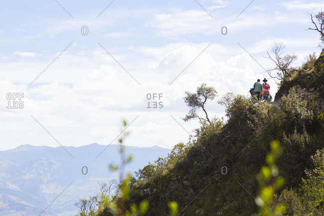 People leading a caravan in Huaraz, Peru