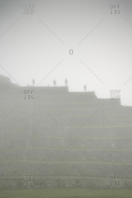 Tourists on the ruins of Machu Picchu in Aguas Calientes, Peru, South America