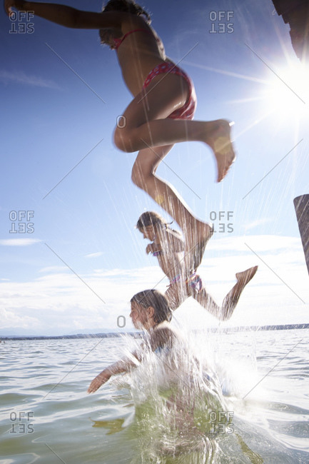 Children splashing in the Starnberg lake in Bayern, Germany