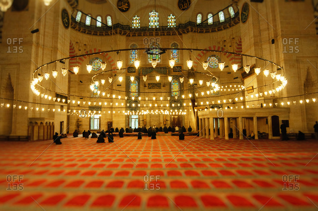 Istanbul, Turkey - December 30, 2010: Hanging lamps above the main prayer area of the Suleymaniye Mosque