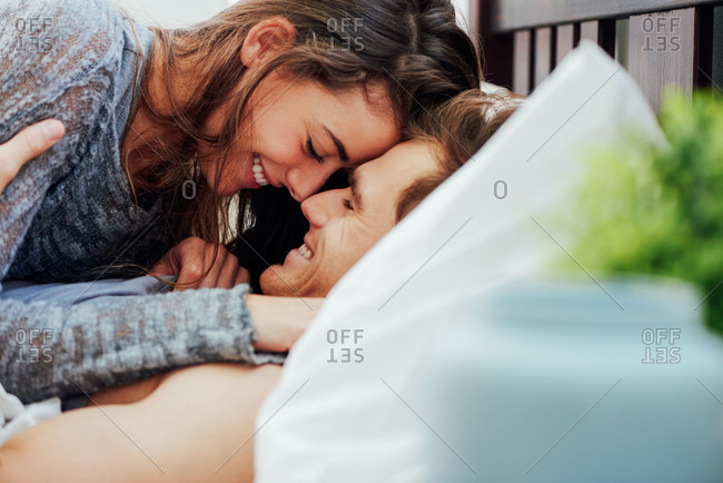 Young couple in intimate moment engaged in foreplay