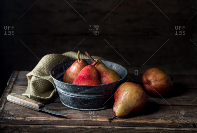 Still life of red pears on a wooden table