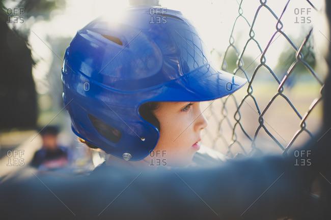 Portrait of young boy in baseball helmet