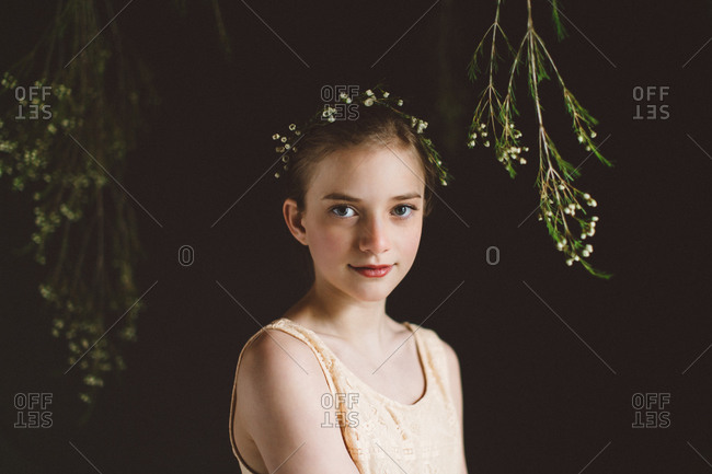 Portrait of young girl with flower crown