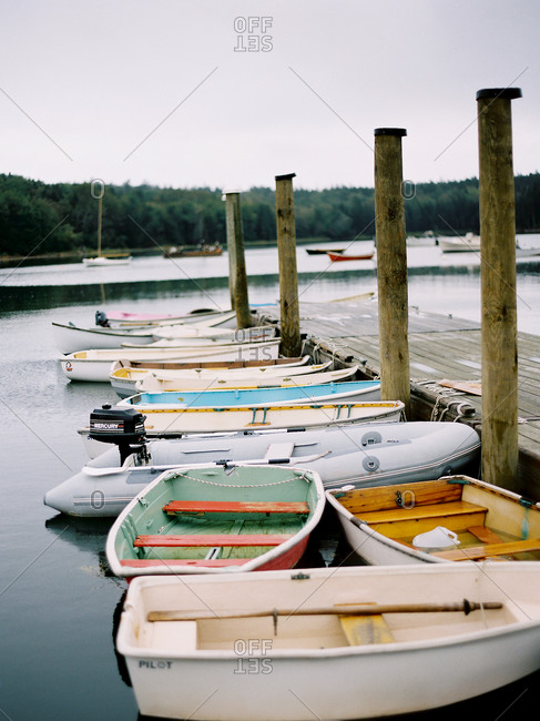 Various boats lined along a dock