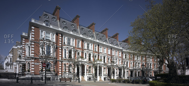 A row of upscale homes in a Kensington neighborhood in London