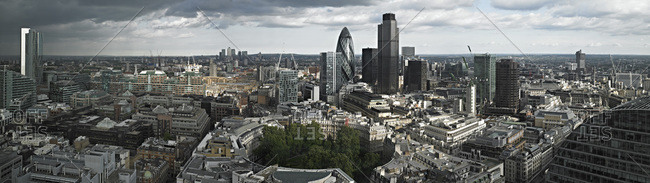 A panoramic view over London with tall buildings and national landmarks, rooftops