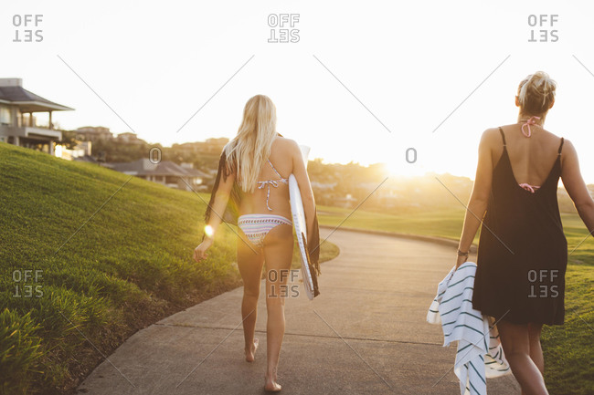 Female surfers walking home from the beach
