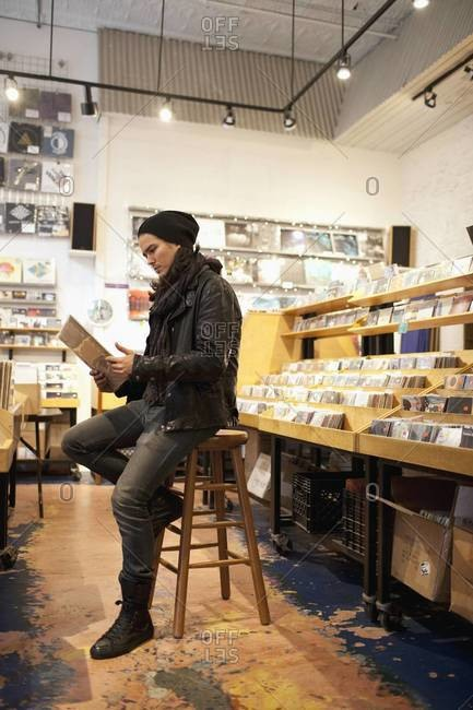 Hip young man in record store