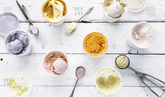 A variety of ice cream flavors on a wood table