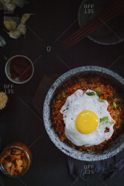 A stone bowl of kimchi fried rice