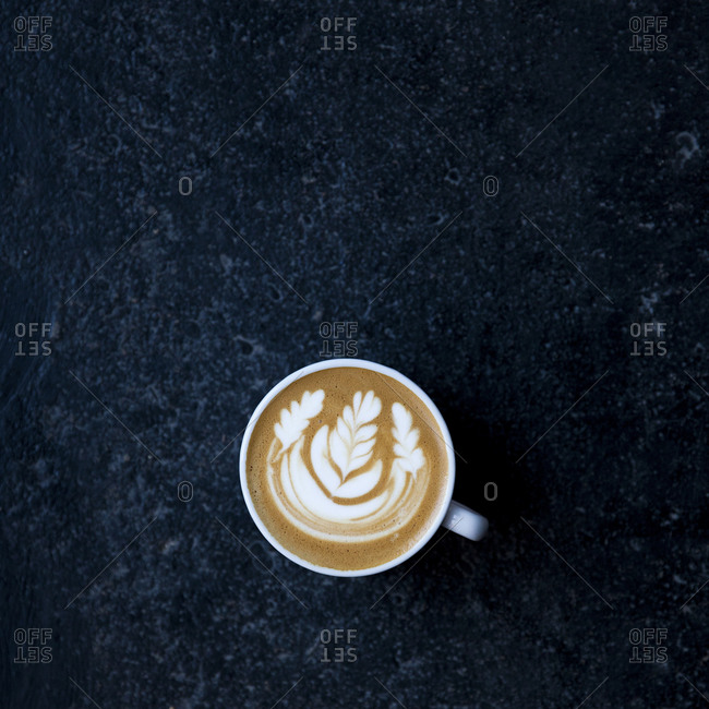 A latte decorated with leaf patterns
