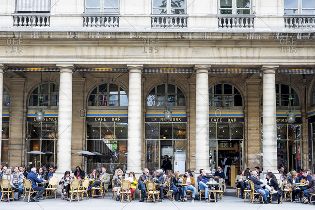 May 8, 2015: A crowd of patrons outside of a cafe in Paris
