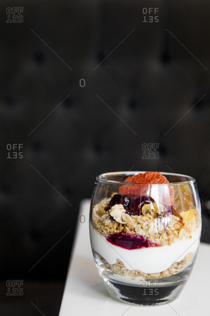 A fruit parfait in a glass cup