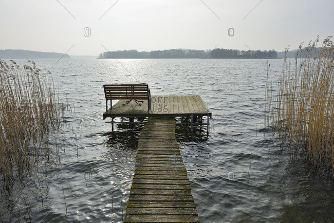 Wooden jetty with bench