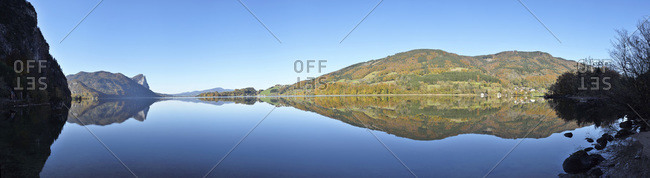 Landscape of quiet lake on sunny day in autumn