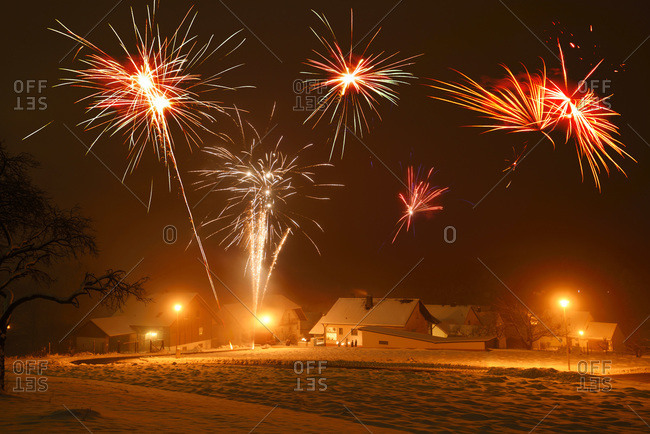 Celebrating new year\'s eve with fireworks in village